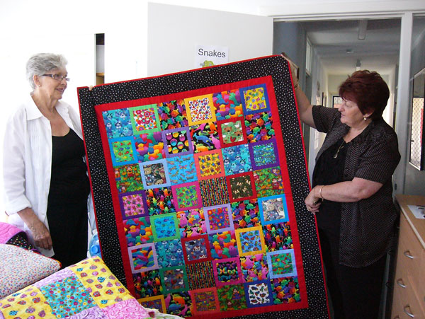 handing-over-quilts