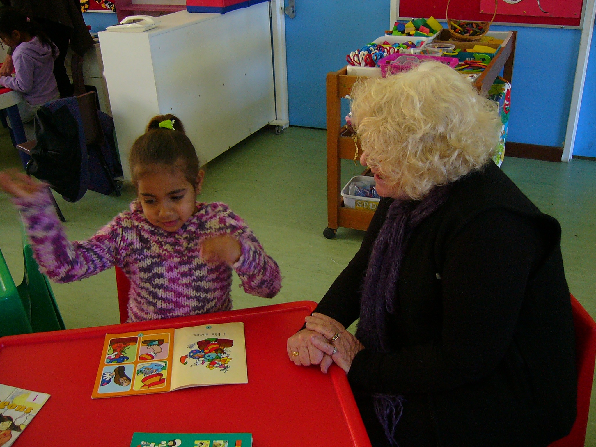 Jan Musk and a young friend experience the joy of reading